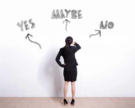 the view option: choice concept - Back view of business woman look white wall and think with yes or no choice