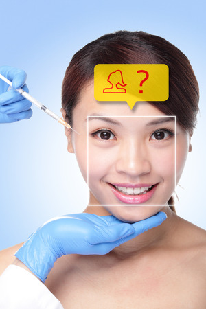 pretty woman face: Plastic Surgery Operation Concept - Close up of cosmetic injection to the pretty woman face. asian beauty