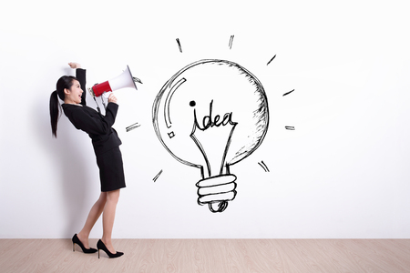 talk show: idea and innovation concept - business woman talking in megaphone