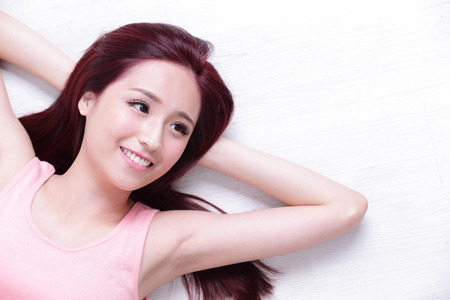 portrait of a Happy young beautiful woman relax lying and look to empty area in the image, great for your design, asian beauty