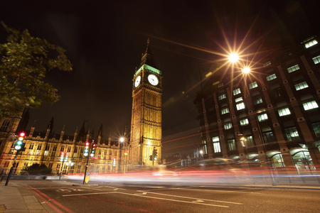 Big Ben and London at night with the lights of the cars passing by, the most prominent symbols of both London and England photo