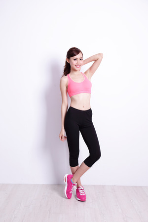 Sport Woman with health figure with white wall background, great for your design or text, asian beauty Imagens