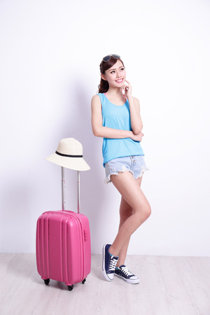 travel luggage: Happy woman tourist travel with white concrete wall and wood floor, asian beauty