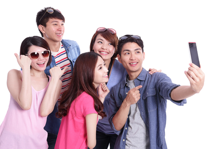 happy teenagers: Selfie - Happy teenagers taking pictures by themselves isolated on white background, asian