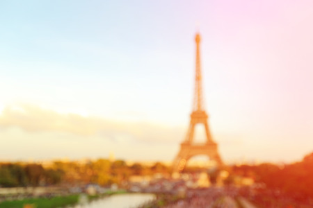 defocus bokeh blurred of silhouette eiffel tower in Paris with sunset, great for your design and background Banco de Imagens