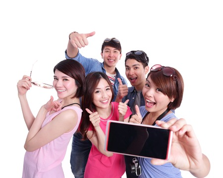 student travel: Selfie - Happy teenagers taking pictures by themselves isolated on white background, asian