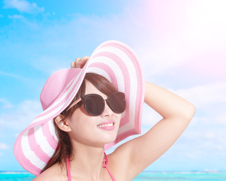 sunscreen: Happy girl wear bikini at sea beach and smile, asian beauty Stock Photo