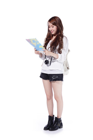 Happy woman tourist holding camera and map on isolated white background 스톡 콘텐츠