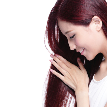 salon background: Beauty woman touch her long hair isolated on white background, asian beauty Stock Photo