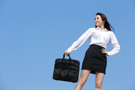 woman arms up: carefree business woman arms up and feel free isolated on blue sky background, asian beauty