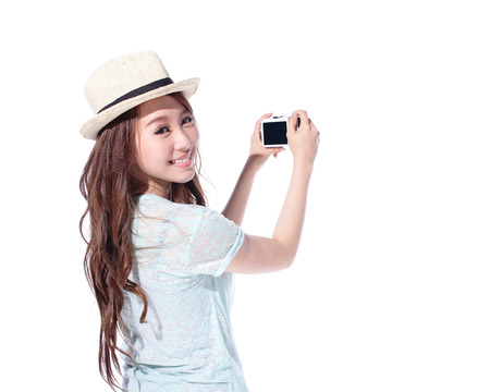Happy travel young woman taking pictures isolated over white background, asian
