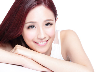 smiles: Charming woman face Smile to you close up while lying isolated on white background, asian girl Stock Photo