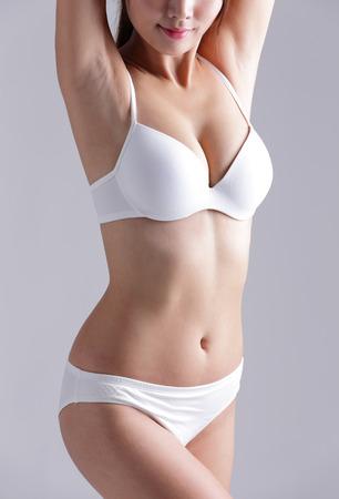 panties: Hermoso cuerpo delgado de la mujer aislada en el fondo gris Foto de archivo