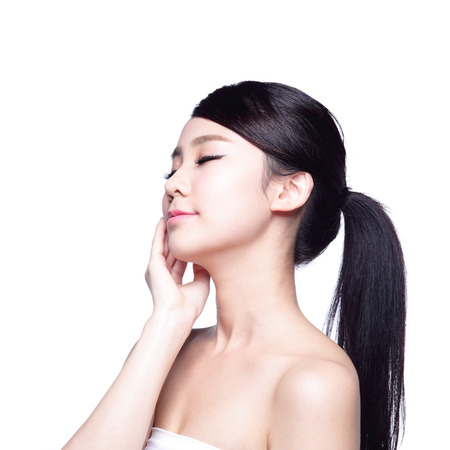 beauty girls: beauty portrait of a young woman touch her face isolated on white background, concept for health , asian beauty