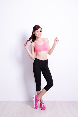 skinny woman: Sport Woman with health figure with white wall background, great for your design or text, asian beauty Stock Photo
