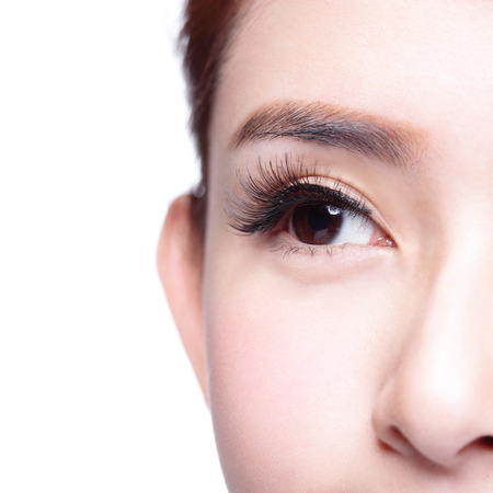 close   up: Beautiful woman eye with long eyelashes. asian model Stock Photo