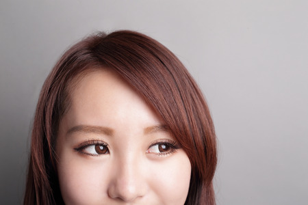 asian businesswoman: Beautiful smile happy woman eye look to empty copy space isolated on gray background. asian beauty