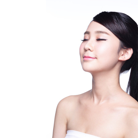 neck: beauty portrait of a young woman relax closed eye isolated on white background, asian beauty