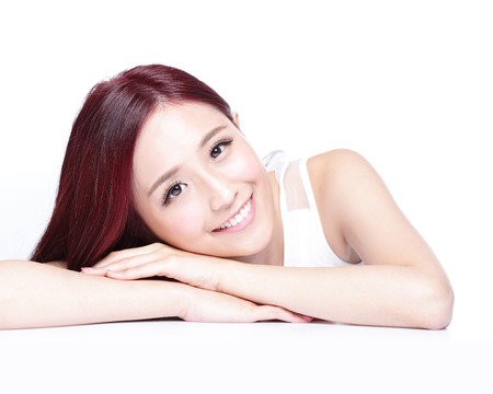 model face: Charming woman face Smile close up while lying isolated on white background, asian girl