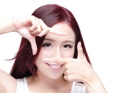 Woman face and eye care and she making frame with hands, asian woman Stock Photo - 42940543