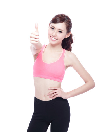 Sport girl show thumb up isolated on white background