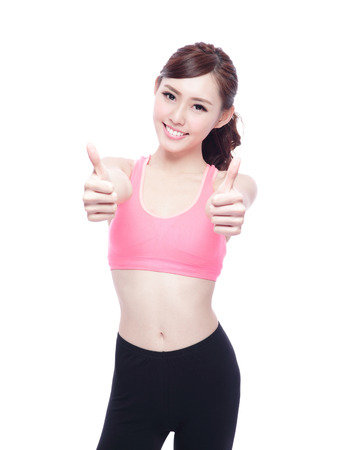 weight loss success: Sport girl show thumb up isolated on white background