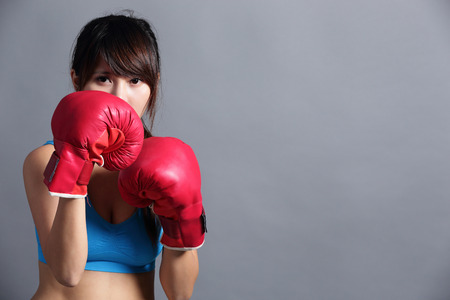 female boxing: Woman in boxing gloves, asian beauty