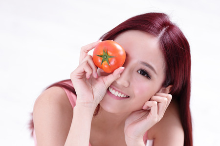 tomates: Health girl show tomato with smile face, health food concept, asian woman beauty Banque d'images