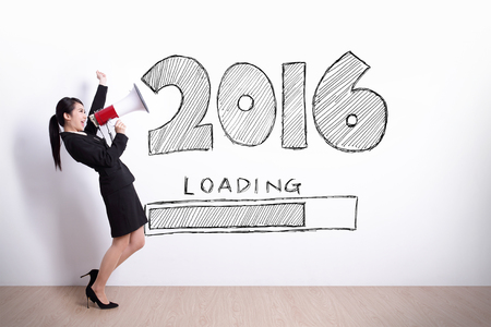 business woman talking in megaphone with 2016 new year on white wall background