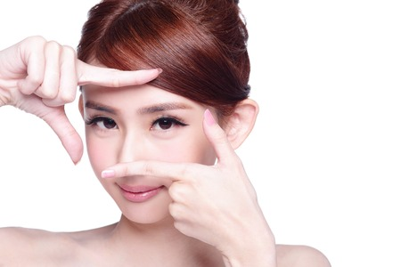 Woman face and eye care and she making frame with hands, asian beauty Фото со стока