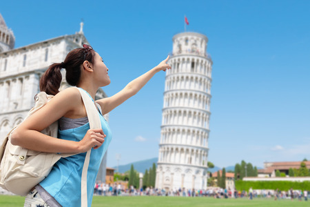 tower: Happy woman travel in Italy, Leaning Tower of Pisa Stock Photo