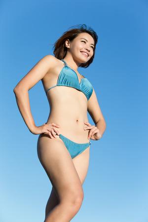 hot body girl: Happy girl wear bikini at sea beach and smile, asian beauty Stock Photo