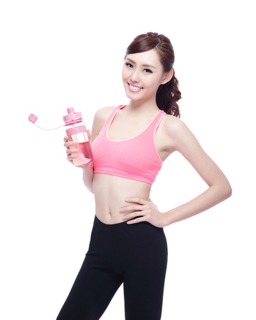 Sport girl with water isolated on white background. Running fitness sport woman jogging smiling happy. asian beauty