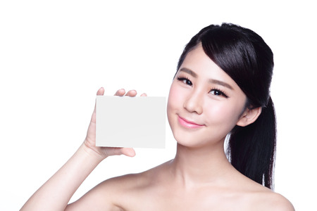 Beauty Skin care woman showing white billboard (empty Copy space), with clean face skin, concept for skin care, asian