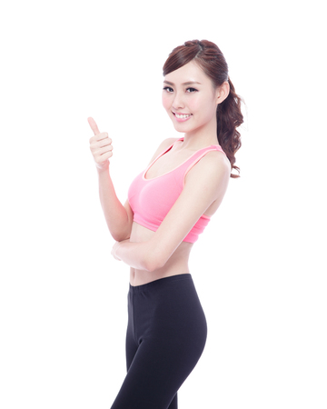 okay sign: sport woman thump up isolated on the white background, asian