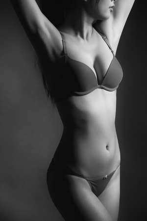 hot breast: Attractive Sexy woman with beautiful body posing and wear underwear in monochrome black and white tone