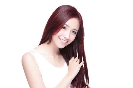 Schoonheid vrouw raakt haar lange haren op een witte achtergrond Stockfoto