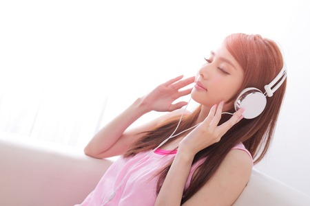one person: Young beautiful woman enjoying the music at home