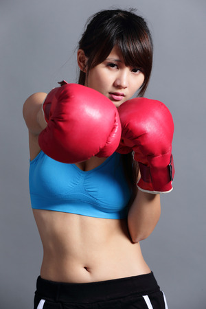 Woman with boxing gloves, asian beauty