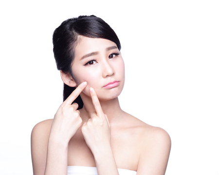 problem: Face Skin Problem - young woman unhappy touch her skin isolated, concept for skin care, asian