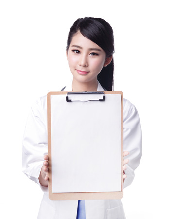 surgical coat: Smiling medical doctor woman show copy space. Isolated over white background. asian Stock Photo
