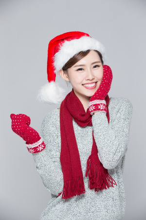 Happy Christmas Woman isolated on gray background, asian