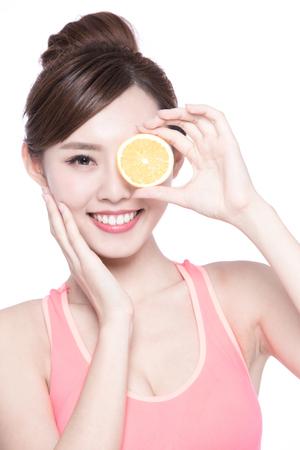 health woman: Happy Woman show orange benefit to health, asian beauty