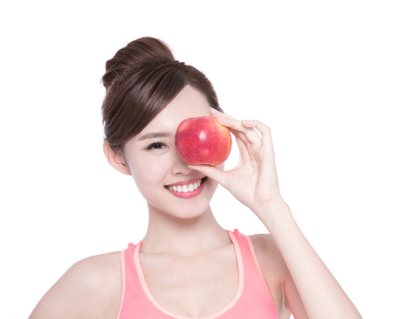 health woman: Happy health woman show apple benefit to health, asian beauty