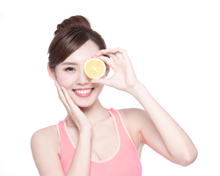 asian sport: Happy Woman show orange benefit to health, asian beauty