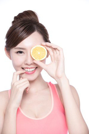 beauty and health: Happy Woman show orange benefit to health, asian beauty