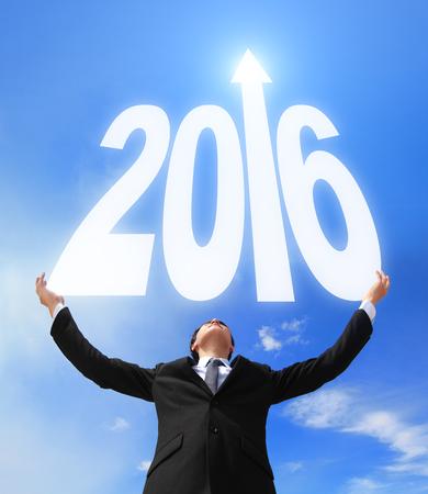 new Year: Happy new year - Business man holding 2016 nuova fantasia anno con cielo e nuvole, asiatico Archivio Fotografico