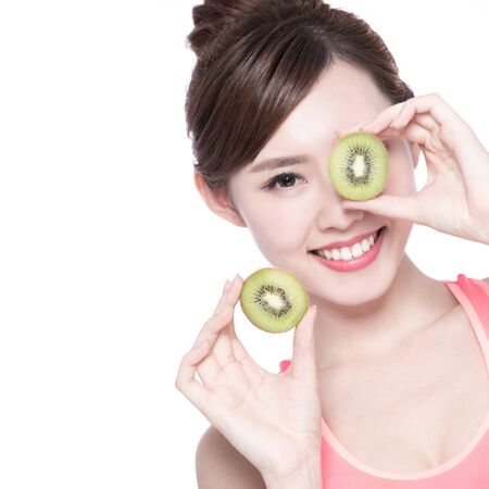 beautiful model: Beauty woman and Kiwi fruit - The woman is dieting healthy isolated on the white background, asian female
