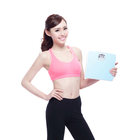 scale model: Health concept, Sport girl hold weight scale isolated on white background. asian beauty