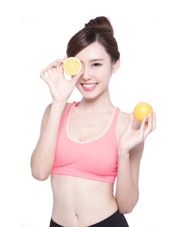 skin care woman: Happy Woman show orange benefit to health, asian beauty